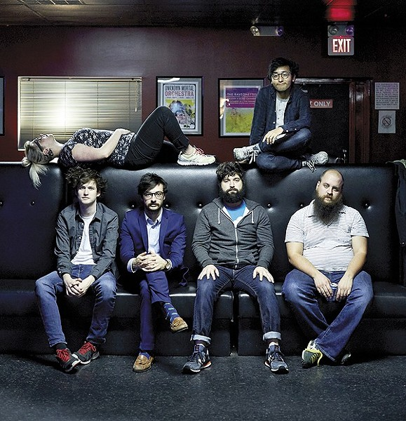 Foxing. Member Ricky Sampson sits on the top of the couch. - PHOTO BY THEO WELLING