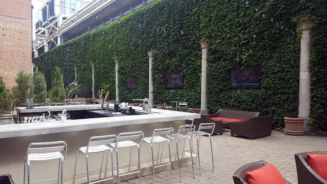 Scapegoat and Scape's shared courtyard features a bar, several TVs, dining and soft seating and the freedom to order from either tavern or bistro. - KAVAHN MANSOURI