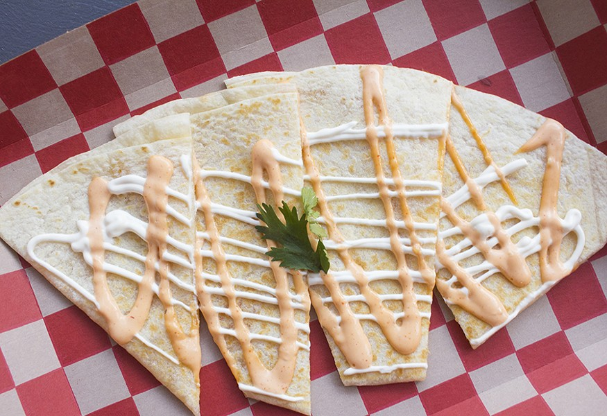The cheese quesadilla is topped with sour cream and aioli. - PHOTO BY MABEL SUEN