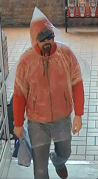 Full-length shot of the poncho bandit. - COURTESY COLLINSVILLE POLICE