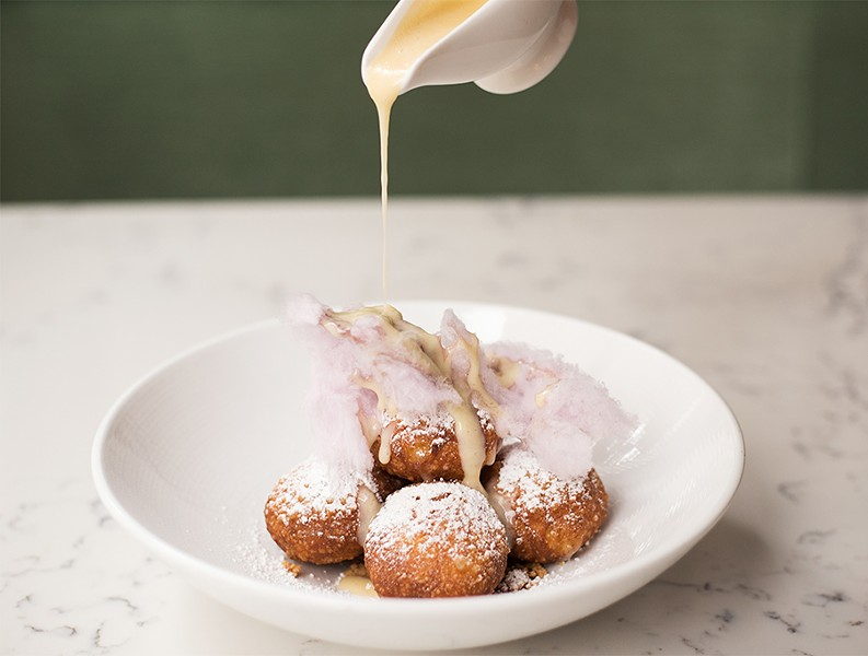 Gooey butter donuts try for a new spin on the St. Louis classic. - MABEL SUEN