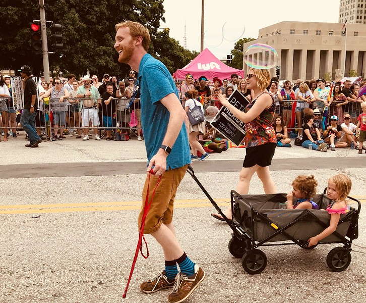 The author and his family march in a past Pride parade. - COURTESY OF PETER MERIDETH
