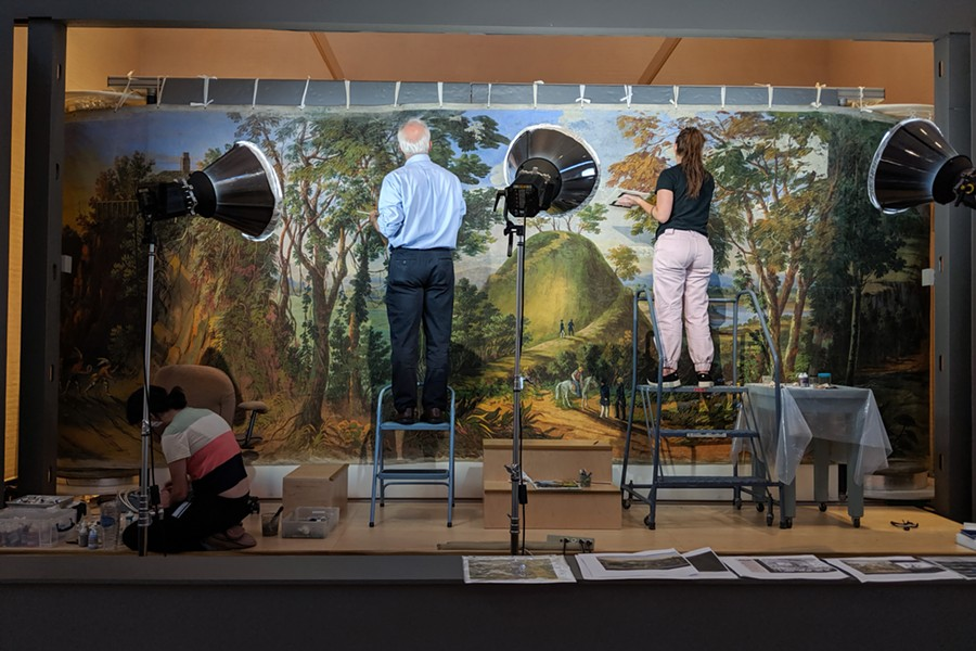 Conservators restoring Panel No. 17 of the massive panorama. - DANNY WICENTOWSKI