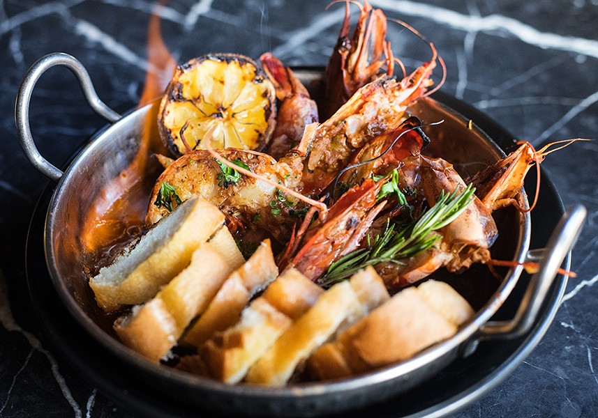"""The """"Flaming Wicked Prawns"""" serve jumbo head-on prawns in a broth of dark beer, sherry wine, Bait spice and fresh herbs. - MABEL SUEN"""