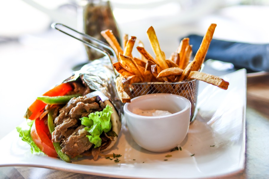 The lamb gyro filled with red onion, lettuce, tomato, green bell peppers and tzatziki sauce. - CHELSEA NEULING