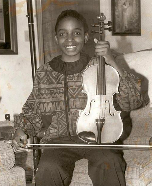 Conaway with her violin after winning a bronze medal at a state music competition at the age of 10. - COURTESY SYRHEA CONAWAY