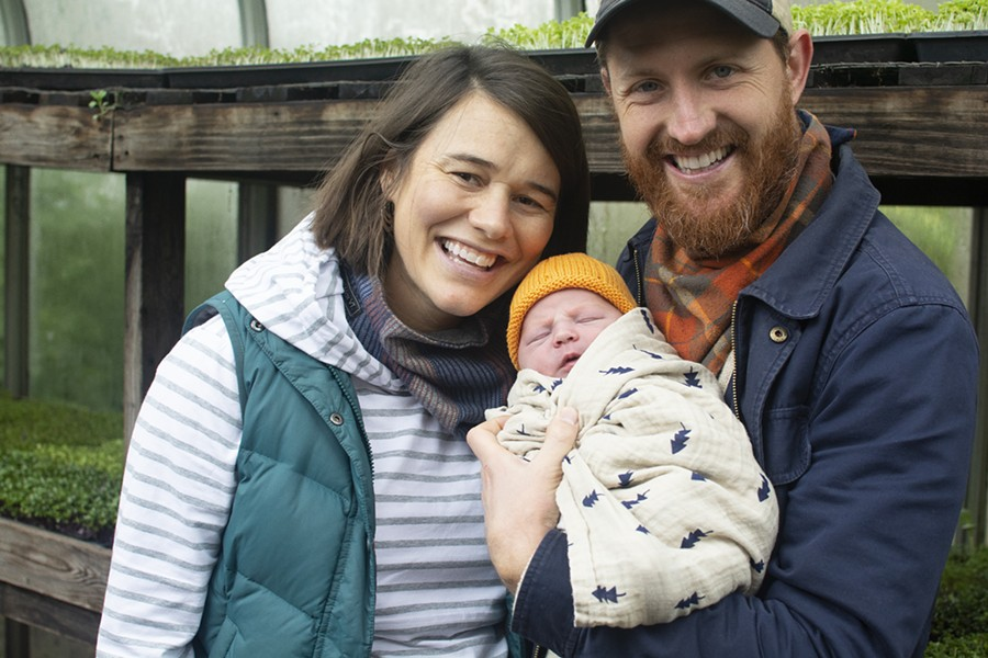 Mary Densmore, baby Autumn and James Meinert are stewards of the earth at Bee Simple City Farm. - ANDY PAULISSEN