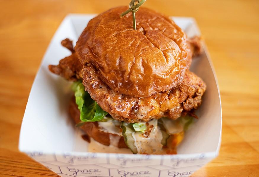 The late-night chicken sandwich with lettuce, onion, pickles, Comeback sauce and added queso on a brioche bun. - MABEL SUEN