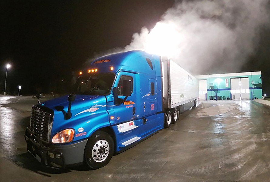 Steam rises from Chet Gordon's truck and trailer after being washed at 1 a.m. at the Blue Beacon Truck Wash in Antioch, Tennessee, on Saturday morning, February 15. - CHET GORDON