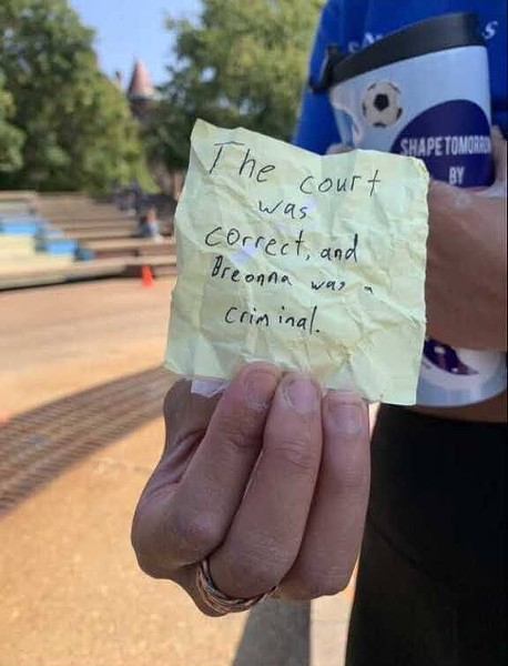 """The note found near the Clock Tower after the defacement, reading """"The court was correct, and Breonna was a criminal."""" - ARIC HAMILTON"""