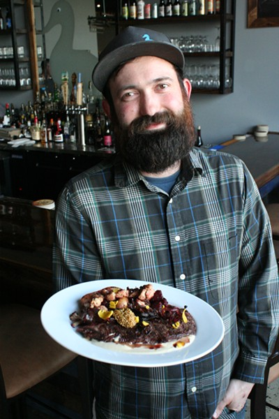 Executive Chef Jordan Knight with Hanger Steak entree - PHOTO BY JOHNNY FUGITT