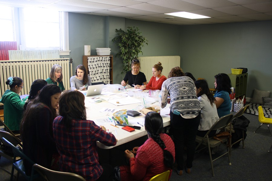 FORAI artisans and volunteers gather at New City Fellowship  on April 1 to make jewelry. - PHOTO BY BILL LOELLKE