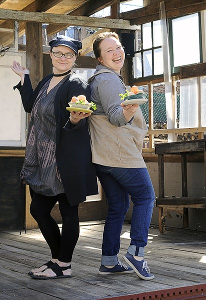 Colleen Clawson and Amanda Jerauld Geimer show off some of Geimer's eggs, fresh from Moonlight Farms. - PHOTO BY KELLY GLUECK