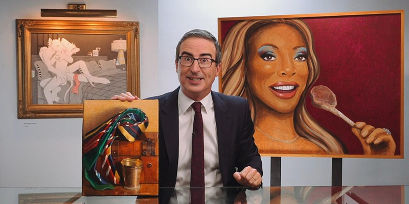 John Oliver poses with his exceptionally weird art collection at the close of Sunday's show.