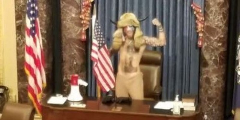 "Jacob Chansley, aka ""QAnon Shaman,"" is a follower of a popular conspiracy cult who made it to the Senate chamber's dais on January 6."