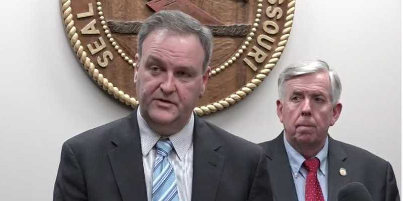 St. Louis County Executive Sam Page, left, and Gov. Mike Parson announce the first COVID-19 case in Missouri, March 7, 2020.