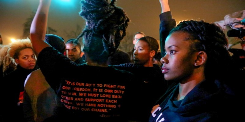 """Ferguson protest leader Brittany Ferrell helped gather people together to chant, """"It is our duty to fight for our freedom,"""" during a protest in South St. Louis on Nov. 23, 2014. The chant is based on a quote by Black Power activist Assata Shakur. Before leading the chant, Activist Ashley Yates told the group, """"We know Black lives matter, and we know that we must fight to prove that."""""""