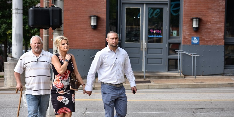 Ex-St. Louis police officer Dustin Boone walks to federal court on June 17 with his wife, Ashley Marie Boone.