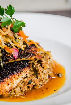 Cast-iron blackened redfish with dirty rice and sauce meunière