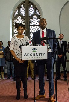 Nicole Nelson and Blake Strode of ArchCity Defenders speak at a press conference announcing a new class-action lawsuit against the city of St. Louis.