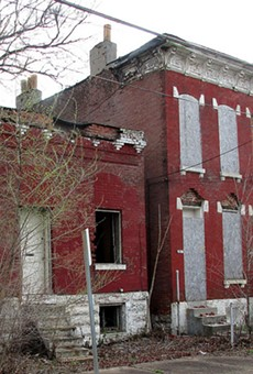 A vacant building in Carr Square. Such buildings cost the city and lead to blight.