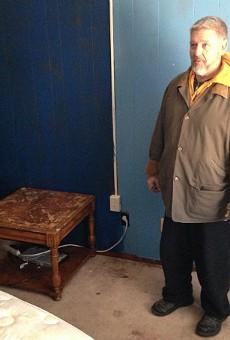 Dojo Pizza owner Loren Copp, shown here at his dojo/pizzeria/residence in Bevo Mill, took pornographic photos of underage girls, prosecutors say.