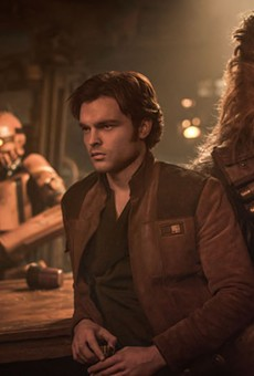 Han and Chewie (Alden Ehrenreich and Joonas Suotamo) hang out at a bar.