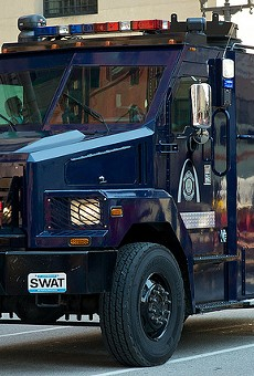 The St. Louis SWAT team shows off its fancy toys at a 2013 parade.