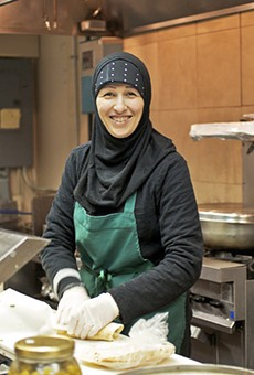 Roudayna Mohsen prepares a sandwich in the kitchen of the Vine.