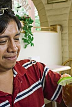 Marvin Hernandez enjoys a shrimp cocktail at Taqueria la Pasadita in Overland.