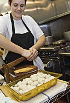 Blanca Delatorre makes fresh corn tortillas in a wood press at Tower Tacos.