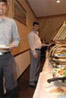 Bobby Vaitla joins a co-worker at Flavor of India's excellent lunch buffet.