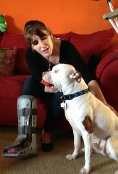 Peggy Cobb with King less than two months after a St. Louis cop shot her in the leg.