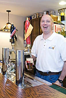 St. Louis Brews member Bob Beckmann pours a glass of his homebrew.