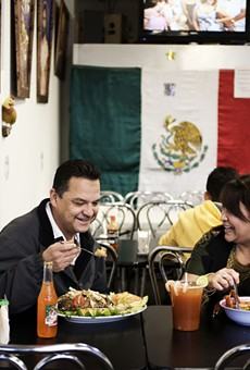 Tony and Brenda Garcia, owners of La Tejana, take time out for a quick lunch.
