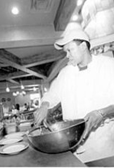Yia Yia's cook Edson Rocha prepares salads.