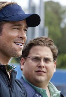 Playing small ball: Brad Pitt and Jonah Hill do a lot with a little in Moneyball.