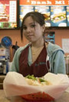 Ba Le employee Tuyen Kieu serves a freshly made banh      mi.