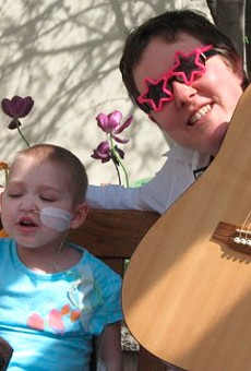 Christy Merrell performs for a young fan.