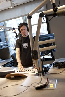 Andy Coco broadcasting The      Rhythm Section from the second-floor      studios of KDHX's newly opened Larry J. Weir Center for Independent Media.
