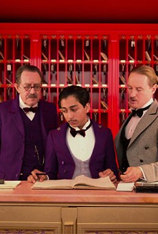 Still of Owen Wilson, Tom Wilkinson and Tony Revolori in The Grand Budapest Hotel.