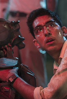 In the Oddly Emotional Chappie, Humans Are Weirder Than the Rapping Robot