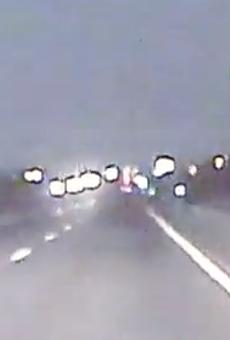 A police dash camera captures the green fireball.
