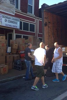 Volunteers gather supplies to ship to Bosnia after devastating floods.