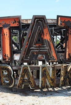 The giant State Bank of Wellston sign, safely removed from its tower.