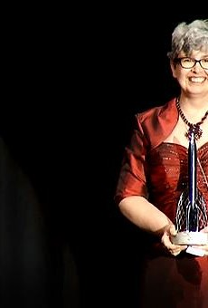 Shrewsbury resident Ann Leckie holds up her Hugo Award for Best Novel at the World Science Fiction Convention in London on August 17.