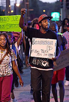 Protesters march in Ferguson on August 18.