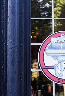 The Kitchen Sink's logo on the front of the restaurant.