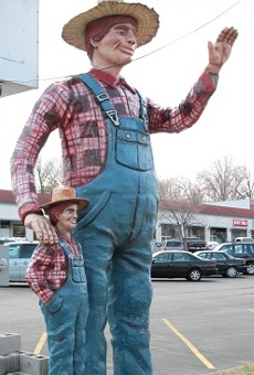 The famous waving farmer outside of Sappington Farmers' Market in Webster Groves.