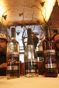 Kyjuan and Murphy Lee with their new line, D'Bes Wine. | Courtesy D'Bes Wine
